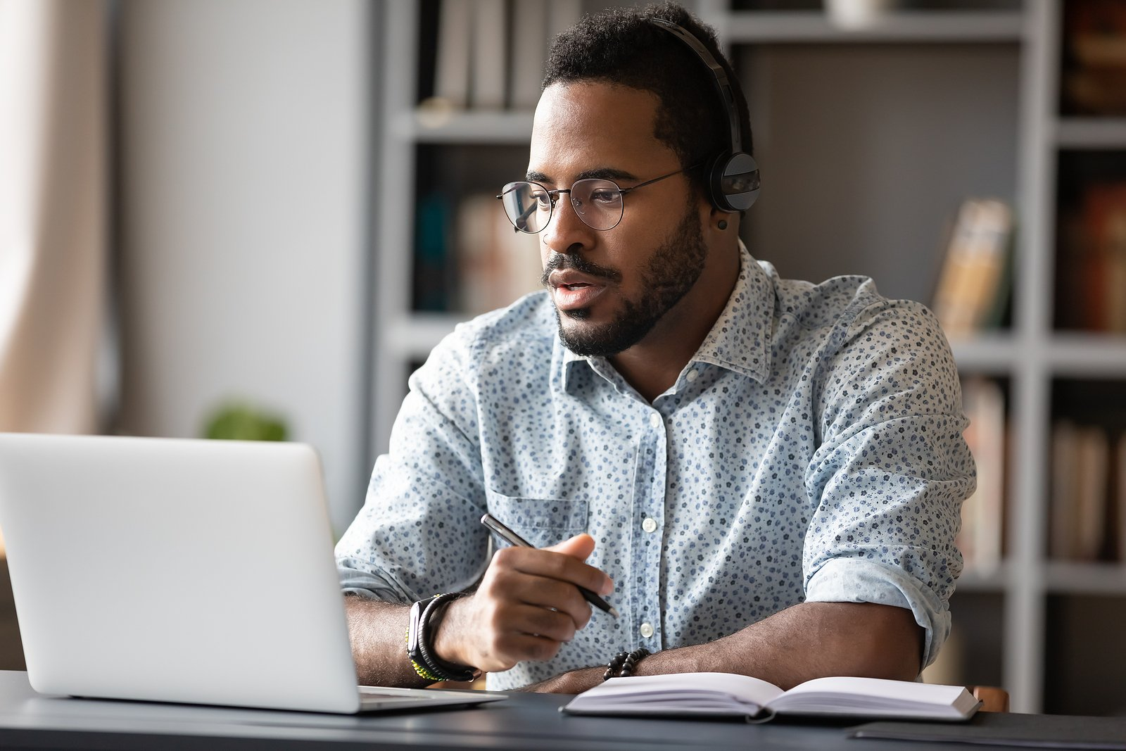 Man learning by watching online course